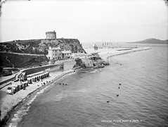 Howth-on-Sea (National Library of Ireland on The Commons) Tags: ireland howth dublin lighthouse beach boats harbour sheets 20thcentury parasols glassnegative irishsea martellotower leinster irelandseye robertfrench williamlawrence bathingmachines nationallibraryofireland lawrencecollection