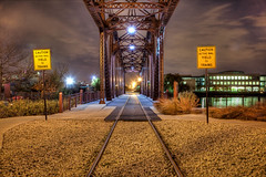 Chicago Plate 084 (Cycle the Ghost Round) Tags: city railroad travel bridge urban usa chicago color fall yellow night train season gold illinois perfect industrial state unitedstatesofamerica country tracks bridges dramatic gritty location neighborhood rails copper drawbridge adjectives description lincolnpark railroads sodiumvapor truss nouns chicagoneighborhoods genericplaces illuminationtimeofdayandweather