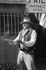 Wild West Show Gunpowder Mills (pg tips2) Tags: show wild two blackandwhite bw west monochrome cowboys blackwhite office cowboy gun barrels smoke smoking pistol western marshal pistols raiders gunpowder marshals gunfire gunsmoke martells 2013