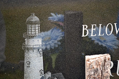 Lighthouse and Flowers (MTSOfan) Tags: cannonhillcemetery lighthouse flowers reflection cemetery gravemarker headstone