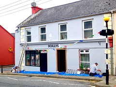 Sprucing up Scullys (JulieK (moving house, very busy)) Tags: scullysfest pub newmarket cork ireland irish traditionalmusic town windows walls painting workmen street carwindow iphone5 2016onephotoeachday bollard