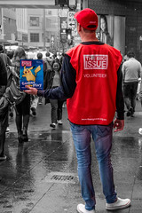 The Big Issue (TOXTETH L8) Tags: cityviews people places rain sydney sydneycbd road streets thebigissue vendors wet passersby downtown