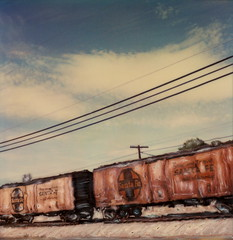 Santa Fe All The Way 2 (tobysx70) Tags: polaroid sx70 sonar emulsion manipulation time zero tz instant film santa fe all the way route 66 gallup new mexico nm ship travel railway railroad rail car boxcar logo rt rte blue sky toby hancock photography