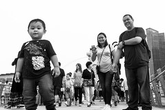 Family (FrozenTales) Tags: a6000 marinabay singapore sony outing steet child kid mummy daddy family bw