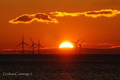 The Silent Power of the Sunset (Graham Cummings) Tags: sun set sunset wind windfarm sky cloud view landscape seascape power sea goldenhour