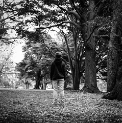 Do you feel small? (spannerino) Tags: newzealand bronicasqa low black white vintage filmlives handprocessed square scanned dof blackandwhite monochrome analogue analog canon9000f film mediumformat pov vintagecamera viewpoint waistlevelviewfinder 6x6 120mm outdoor zenzabronicasqa person