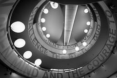 Challenge the Status Quo (Bokehschtig (ON/OFF)) Tags: bmwmuseum bmwworld bmw munich mnchen spiral architecture monochrome blackandwhite schwarzweiss bw sw indoor light shades letters sony a7 sonyalpha7 sonya7m2 sonyalpha7markii