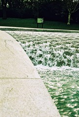 Roll 2 - Princess Diana Memorial Fountain (Cris Ward) Tags: park camera old city uk orange lake color colour building slr london art film water fountain pool yellow architecture rollei analog 35mm vintage landscape daylight frozen movement lomo xpro lomography construction memorial warm cross britain crossprocess grain slide landmark retro hyde architect crossprocessing granite april hydepark analogue manual noise processed e6 yashica highspeed turbulence blown colorshift lsi princessdiana c41 2013 yashicafxd colorreversal cr200 lomolab digibase rolleidigibasecr200