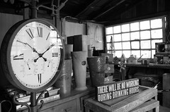 NO working during drinking hours (kimberley1965) Tags: blackandwhite clock vintage garden mono time pentax pennsylvania antique farm shed storefront dairy northeast timepieces flowerpots dairyfarm mercantile