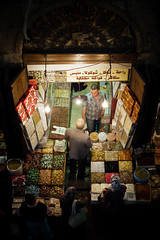 Shopping in Old Damascus (Lil [Kristen Elsby]) Tags: damascus middleeast syria travelphotography souq market alhamidiyya streetphotography shopping syrian dimashq coveredmarket souk panasoniclumixlx3 sweets candy sweetshop candyshop candystore fromabove olddamascus topf25 topv11111