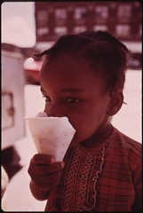Black Ghetto Child Savors A Snow Cone Just Received From A Sidewalk Vendor On Chicago's West Side, 06/1973 (The U.S. National Archives) Tags: chicago africanamerican snowcone environmentalprotectionagency documerica usnationalarchives nara:arcid=556213