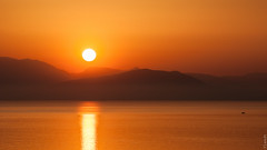 Here comes the sun (Ylandt) Tags: sea orange sun mountains sunrise nikond90 nikkor55200456gifedvr
