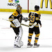 Chris Kelly gets a pat from Tuukka Rask