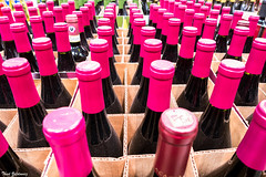 In vino veritas (Thad Zajdowicz) Tags: concept invinoveritas color purple rows repeating repetition bottles wine alcohol closeup zajdowicz alhambra california grocery supermarket leica lightroom availablelight indoor inside shapes symmetry cardboard glass boxes abstract