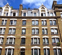Apartment block in the Charing Cross Road (Snapshooter46) Tags: london architecture charingcrossroad apartments brickbuilding multistory yellowbrick londonstocks 1884