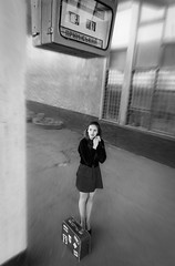 Waiting (Ash and Debris) Tags: schedule bw waiting trainstation suitcase skirt bnw monochrome beauty display girl station case retro blackandwhite