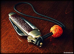 paracord pocket knife lanyard (Stormdrane) Tags: paracord 550cord gutted ungutted gaucho double knife lanyard knot boatswain whistle diamond edc everydaycarry rigging marlinspike lock orange black attachment hiking camping backpacking fishing boating sailing scouting bushcraft geocache tying tighten retention utility decorative useful make hobby craft camillus madeinusa tutorial links