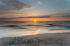 Almost gone (Sicilian1976) Tags: canon6d canon1740 seascape sea clouds sunset sun holland goldenhour beach shelfs zeeland burghhaamstede nisi water pastel