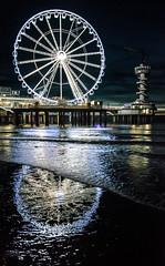 Double round (marielledevalk) Tags: wheel water reflection sea beach evening night light scheveningen holland dutch