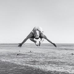 Backflip from the Pier - Waikiki Beach (Oliver Leveritt) Tags: nikond7100 afsdxvrnikkor18200mmf3556gifed oliverleverittphotography hawaii oahu honolulu waikiki waikikibeach monochrome blackandwhite dive backflip