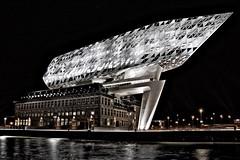 Diamond ship in the city of diamonds (Jochem.Herremans) Tags: building architecture new old night porthouse havenhuis antwerpen antwerp port ship diamond zahahadid