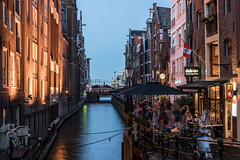 The Watering Hole (McQuaide Photography) Tags: amsterdam noordholland northholland netherlands nederland holland dutch europe sony a7rii ilce7rm2 alpha mirrorless 1635mm sonyzeiss zeiss variotessar fullframe mcquaidephotography adobe photoshop lightroom tripod manfrotto light licht dusk twilight bluehour longexposure stad city capitalcity urban lowlight architecture outdoor outside old oud gracht traditional authentic water reflection waterfront waterside canal colour colours color summer evening avond zomer oudezijdskolk grachtje ozkolk hetkolkje lock sluice kolksluis history historic