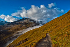 Twilight time on the Furka Pass, the sea of clouds is arriving ...No. 3237. (Izakigur) Tags: izakigur feel flickr furka fixyou thelittleprince twilight uri switzerland myswitzerland musictomyeyes dieschweiz d700 nikkor nikond700 nikkor2470f28 100faves topf25 top300 200faves 250faves 300faves