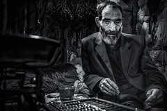 Abacus Man (Axel Halbgebauer) Tags: iran tabriz bazar oldman abacus bw blackandwhite blackwhite market wool middleeast travel sonyalpha sonya7r2 gmaster sonyimages sony street streetphotography streetportait hands face portrait beard
