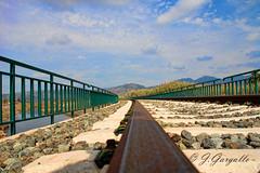 Puente sobre el rio (J.Gargallo) Tags: puente via railes tren ferrocarril rio cielo azul canon canon450d canonefs18200 eos eos450d 450d castelln comunidadvalenciana espaa spain