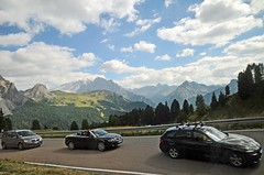 Climb every mountain (Vee living life to the full) Tags: italy leger travel touring holiday landscape rock pass pordoi sella towers sasspordoi mountain people nikond300 heathaze valley floor motorcycle view car park road sky cloud blue cyclists effort drive driving hairpin bend