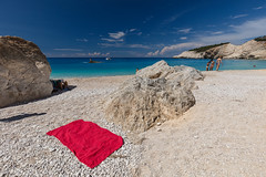 The towel in red (Thomas Mulchi) Tags: portokatsiki lefkada ionianislands greece 2016 sea beach azure turquoise summer humid hot notphotoshopped people red towel redtowel thetowelinred gr