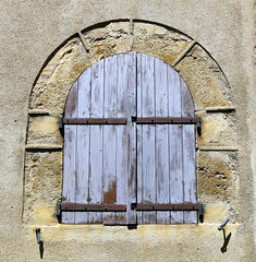 An arched window with iron strap-hinged shutters, Ampus, Var, Provence, France (Hunky Punk) Tags: window house stone arch arched rounded shutters blue light pale ampus var provence france dwwg strap hinge iron