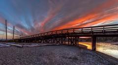 Burning Bridge (Paul Rioux) Tags: outdoor bc vancouverisland colwood esquimaltlagoon bridge sunset dusk clouds prioux