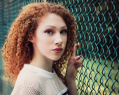 Delaney (rhn3photo) Tags: 2016 delaney july model pawleysisland southcarolina blueeyes redhead sc fence chainlink red green people portrait outdoor tenniscourt mood curls bokeh