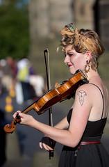 Faith - 6 (Alastair 2008) Tags: fiddle female street entertainer bow piercing strap blacktop