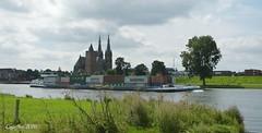 De Maas bij Cuijk (Cajaflez) Tags: cuijk demaas rivier river rivermaas boot binnenvaart containerboot boat church kerk water nirvana
