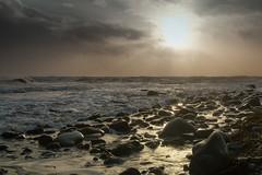 A Little Light (jillyspoon) Tags: monreith stones rocks seashore evening stormy beach coast irishsea canon canon70d waves dusk