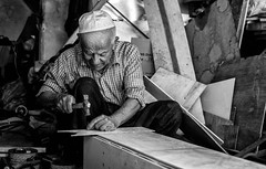 Old carpenter (Saman A. Ali) Tags: street streetphotography blackwhite blackandwhite people portrait documentary fujifilmxt1 environmentalportrait old man environmental carpenter