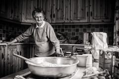 Ag Déanamh Aráin / Making Bread 09 (soilse) Tags: 2009 anghaeltacht cnocastolaire deireadhfómhair donegal dúnnangall gaeltacht gweedore ireland mum october october2009 tateandlyle tírchonaill agbacáil agdéanamharáin arm arán baking bakingtin blackandwhite bread breadmaking ceird cisteanach cistin concentration craft daylight daylightportrait flour glassjars greased greasedbakingtin greasedtin hands ingredients jars kitchen makingbread monochrome naturallight portrait portraiture portráid raising sultanas table tins treacle tábla éirinn