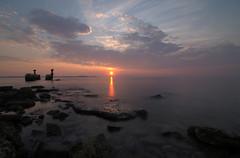 And the sun goes down... (A.Keskin) Tags: sunset sun croatia peroj beach longexposure sky clouds silky smooth water sea ocean rocks