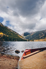 Serenity (Derek Cronk) Tags: colorado fall fallcolors boat canoe lake water aspens colors mountains mountain mountainlake bokeh cloudy clouds rockymountains peaceful beautiful landscape calm floating nature wilderness rocks