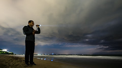 Looking for a Direction (Yoan Mitov) Tags: selfie self portrait evening night long exposure torch light sky sea clouds man standing burgas bulgaria fuji xt10 samyang 12mmf2