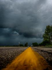 Crossing Paths With A Beast (Explore 7.22.2016) (MacDonald_Photo) Tags: jamieamacdonald olympus omd penf 43 mft microfourthirds trailblazer olympustrailblazer httpwwwjmacdonaldphotocom zuiko zd olympuspenf olympuspen weather storm stormclouds clouds m50 jacksoncountymichigan yellow road