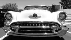 This Is Your Fathers Oldsmobile! (Viejito) Tags: auto show california blackandwhite bw usa sun hot reflection classic monochrome car metal america canon vintage stars geotagged blackwhite amrica automobile gm unitedstates antique broadway headlights highlights voiture powershot grill chrome hotrod rod santamaria grille amerika oldtown radiator olds oldsmobile generalmotors s100 clarkavenue wagen orcutt amrique leadsled speedshop canons100 hotheads johncarey oldorcutt bentaxles fresnostreetrods geo:lat=34864079 geo:lon=120447282