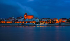 Storm passing over Toru (TanzPanorama) Tags: city toru poland travel tourism medieval architecture building storm cloud blue bluehour le unseco worldheritage copernicus astronomy flickr tanzpanorama sony a7ii ilce7m2 town cityscape wisa vistula river riverfront fe1635mmf4zaoss fe1635 night