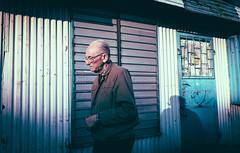 Sadness of Blue Hour (marcin baran) Tags: man human person walk walking stranger candid candidphotography candidshot blue shade shadow color colour old older door doors buildings city urban street streetphotography streetphoto gliwice polamd poland polska marcinbaran fuji fujifilm x100 x100t element factor