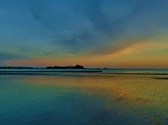 A colourful sunset over a reflective beach (Richard Bougeard) Tags: jersey weather
