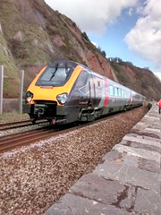 Heading for Holidays (Her Radiance) Tags: trains railwaylines railways travel devon seawall holidays journeys track pebbles wall