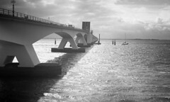 Go Boating (Arne Kuilman) Tags: akarette xenon 50mm lens ilford xp2 nederland netherlands handheld c41 zeeland zeelandbrug zierikzee brug boot boat schneiderkreuznach xenon50mmf2 bridge