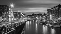 Slow it down (McQuaide Photography) Tags: amsterdam noordholland northholland netherlands nederland holland dutch europe sony a7rii ilce7rm2 alpha mirrorless 1635mm sonyzeiss zeiss variotessar fullframe mcquaidephotography lightroom adobe photoshop tripod manfrotto light licht water unesco heritage stad city urban lowlight architecture outdoor outside waterfront gracht capitalcity capital building canal boat authentic classic blackandwhite blackwhite bw mono monochrome longexposure 169 widescreen panoramic boot canalhouse canalboat rokin traffic speed movement motion lighttrail night nacht nightphotography skyline road oudeturfmarkt old